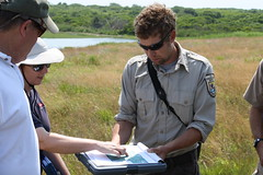 Nick Ernst, Widlife Biologist for U.S. Fish and Wildlife Service and Marci Cole Ekberg, Coastal Ecologist for Save the Bay, discuss marsh elevation at Sachuest Point National Wildlife Refuge in Rhode Island.