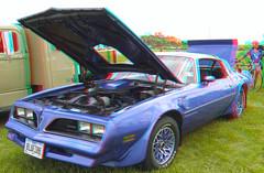 model car(0.0), stock car racing(0.0), convertible(0.0), automobile(1.0), automotive exterior(1.0), vehicle(1.0), pontiac firebird(1.0), land vehicle(1.0), muscle car(1.0), coupã©(1.0), sports car(1.0),