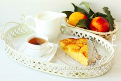 white breakfast with homemade peach pie, tea, milk…