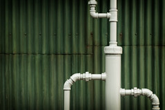 Water works pipes in front of grunge background