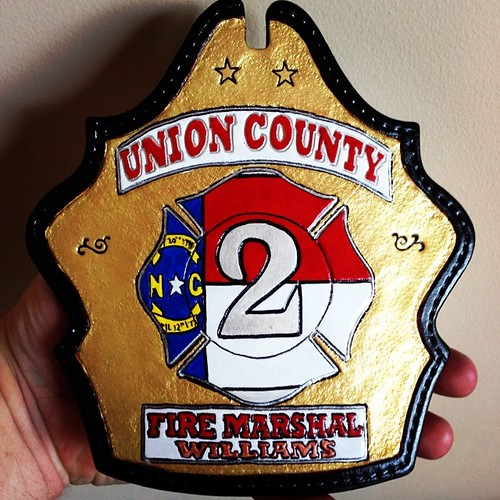 Gold fire marshal custom fire helmet shield with NC flag maltese