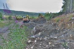 Landskap med gravemaskiner.