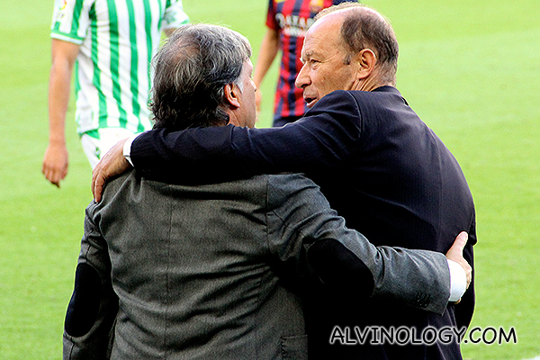 The two coaches hugging after the match