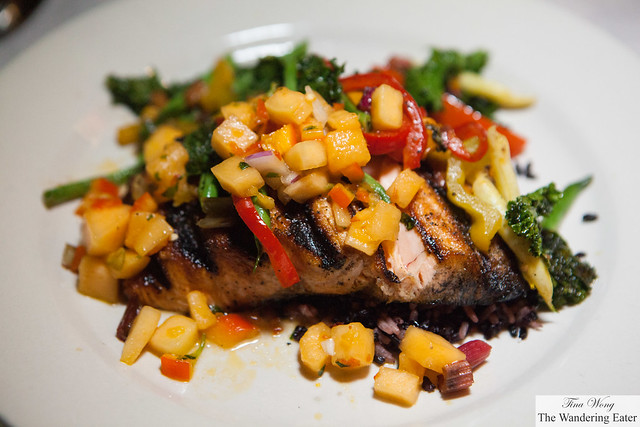 Grilled salmon on black rice, mango-pineapple salsa and kale and bell pepper salad