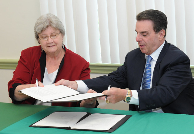 Dr. Jack Varsalona signs the Bachelor of Science in Nursing agreement with Salem Community College President Joan Baillie on July 22, 2014.