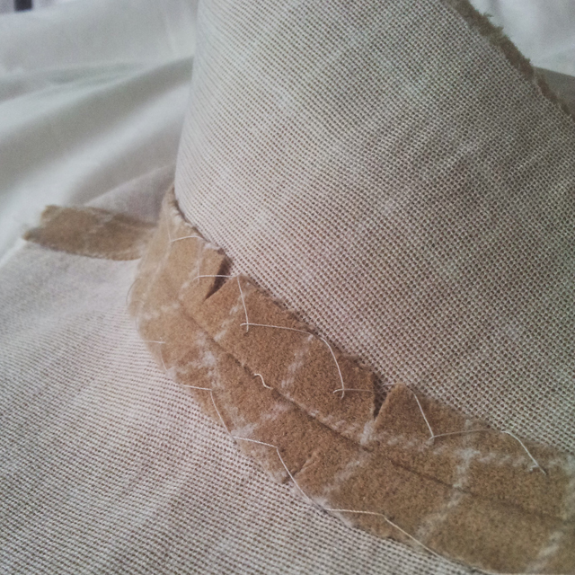 notched and catch stitched collar seam encourage curve
