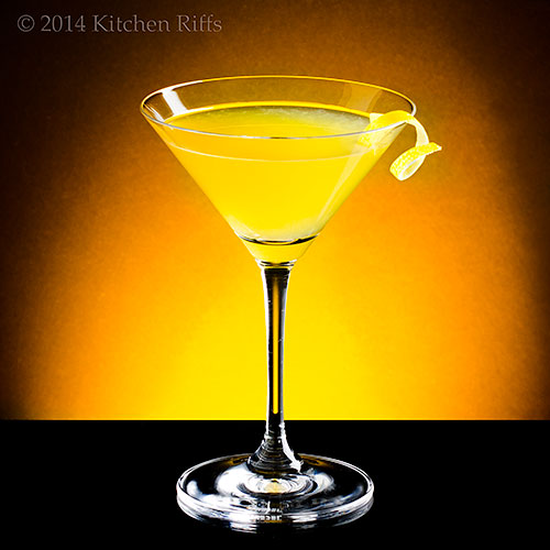 Sundowner Cocktail with lemon twist garnish
