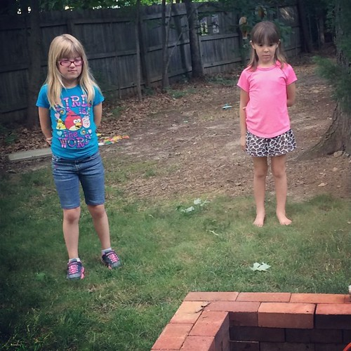 Catie & Elizabeth. 7 year-old cousins. Keeping a safe distance from the fire pit while we cooked hot dogs.