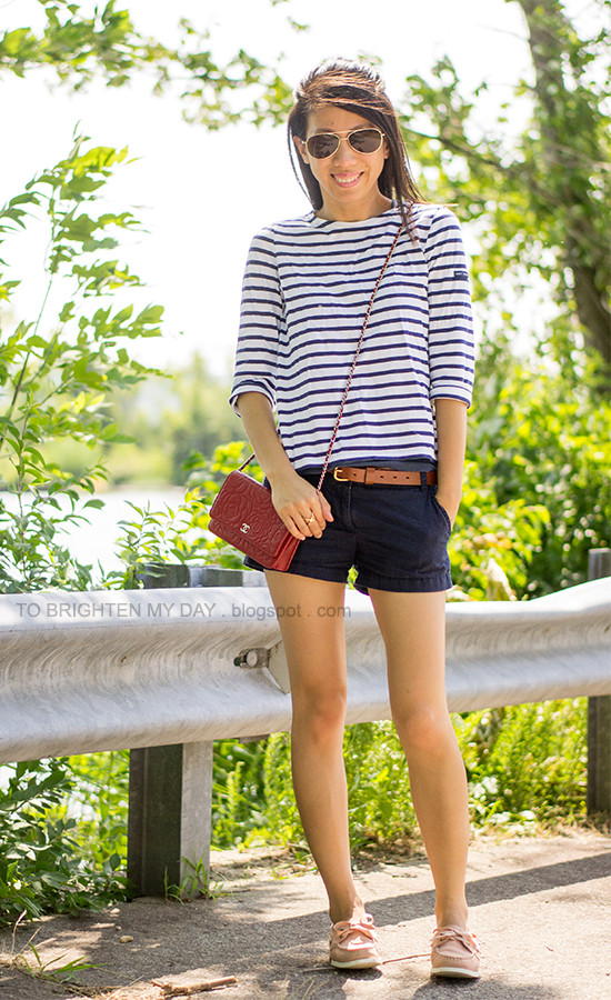 striped top, navy shorts, red crossbody bag, pink boat shoes