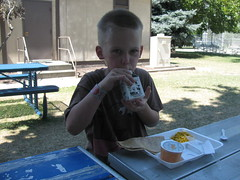 Boy eating lunch at the Activities Center.  Mm! Quesadillas!