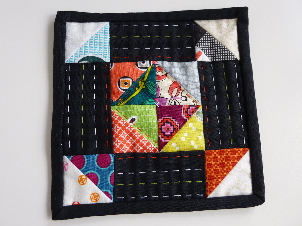 Scrappy Churndash mini quilt made with Denyse Schmidt fabrics and low volume background by fabricandflowers.
