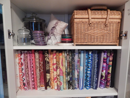 Sewing Room:  Cabinet top shelves