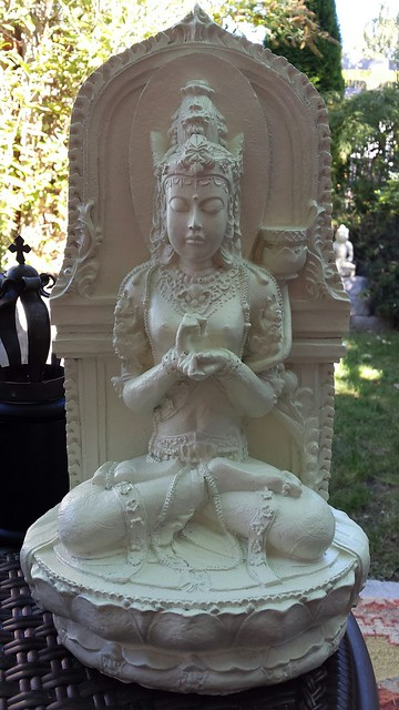 Prajnaparamita seated on a lotus holding her hands in the dharmachakra mudra, A Garden For the Buddha, Seattle, Washington, USA