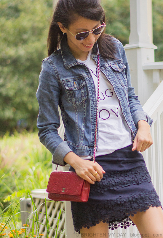 denim jacket, graphic tee, navy lace skirt, red crossbody bag