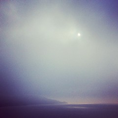 On the Tay Bridge picking out the sun from the fog and watching pools of light break through onto the river