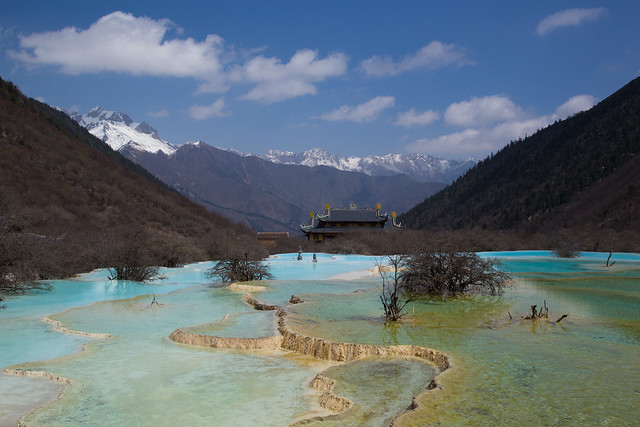 Huanglong, a taoist temple nested in the mountains and surrounded by travertine pools
