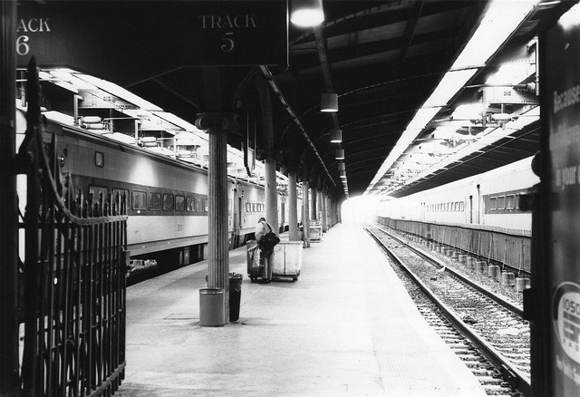 Track 5 of the Hoboken Erie Lackawanna Train Terminal. Electrodes, capacitors, steel, bolts, and concrete bathed in harsh light and shadow. October 1989.