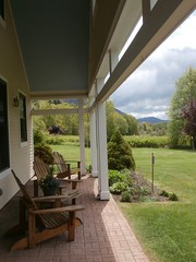 Sherburne Memorial Library posted a photo:	enjoy a glass of tea on our back porch!