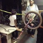 Cases and Darnisha fixing her bike tires