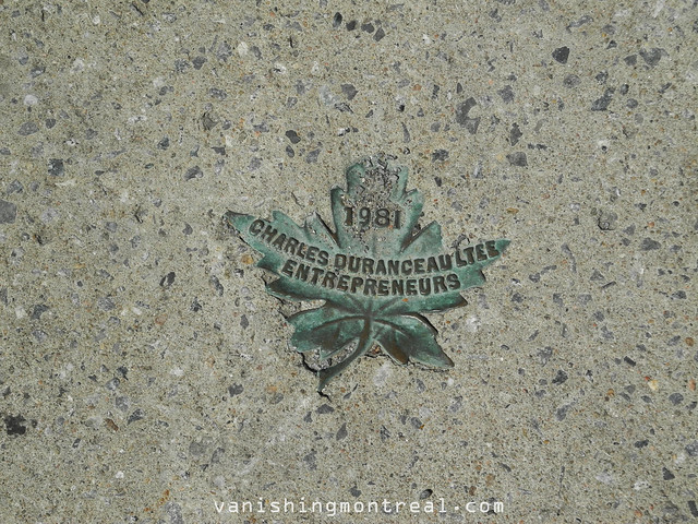 Sidewalk marker on corner of Evelyn and Regina 1