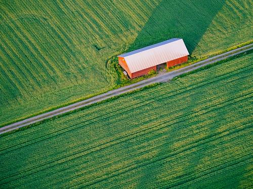 road shadow summer nature barn finland landscape evening countryside europe olympus aerial telephoto fields hotairballoon omd sipoo em5 panasonic100300mm