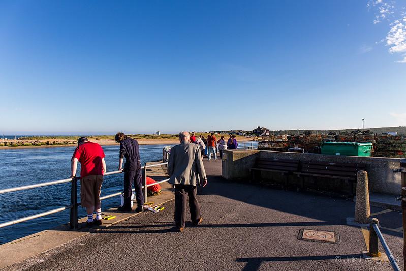 Dad wanders on Mudeford Quay
