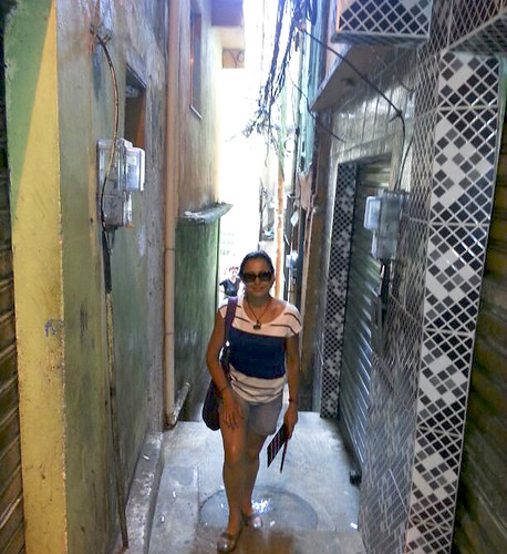Theresa standing in a back street of Favelas