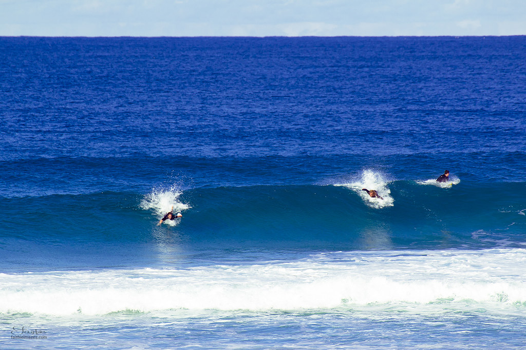 Three men doing bodysurfing