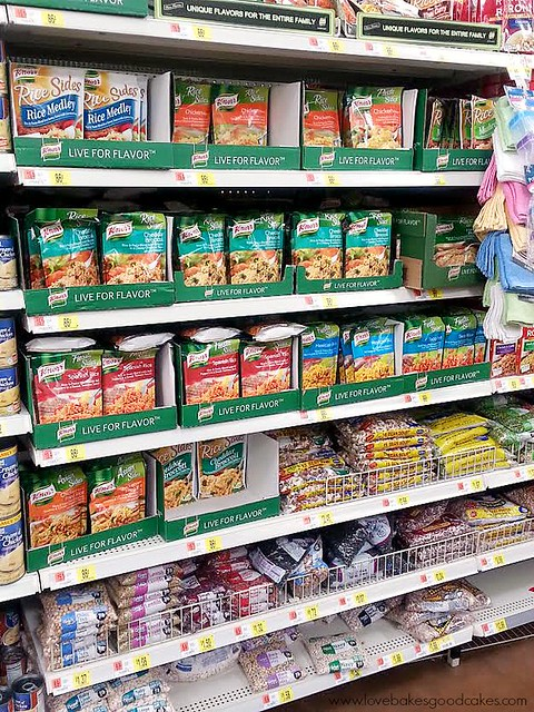 Grocery store isle with Knorr Fiesta Sides Taco Rice and Knorr Chicken-flavored Homestyle Stock product on shelf.