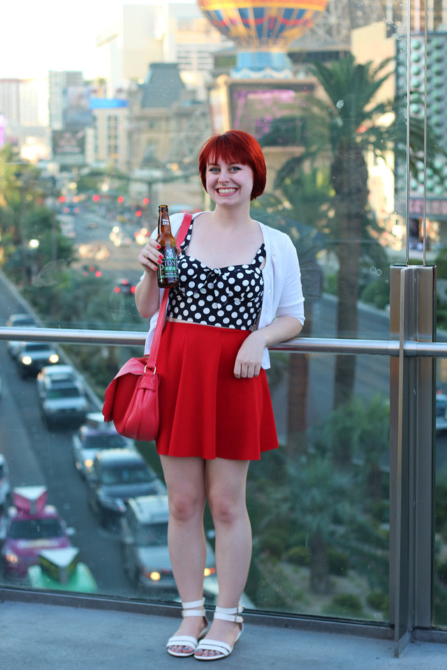 Polka Dot Bustier Top, White Cardigan, Red Neoprene Skater Skirt, and White Sandals