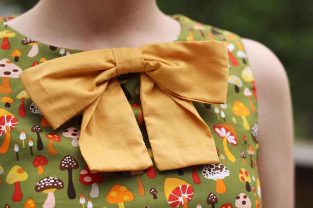 Mustard Yellow Bow on a Green Retro Mushroom Print Dress
