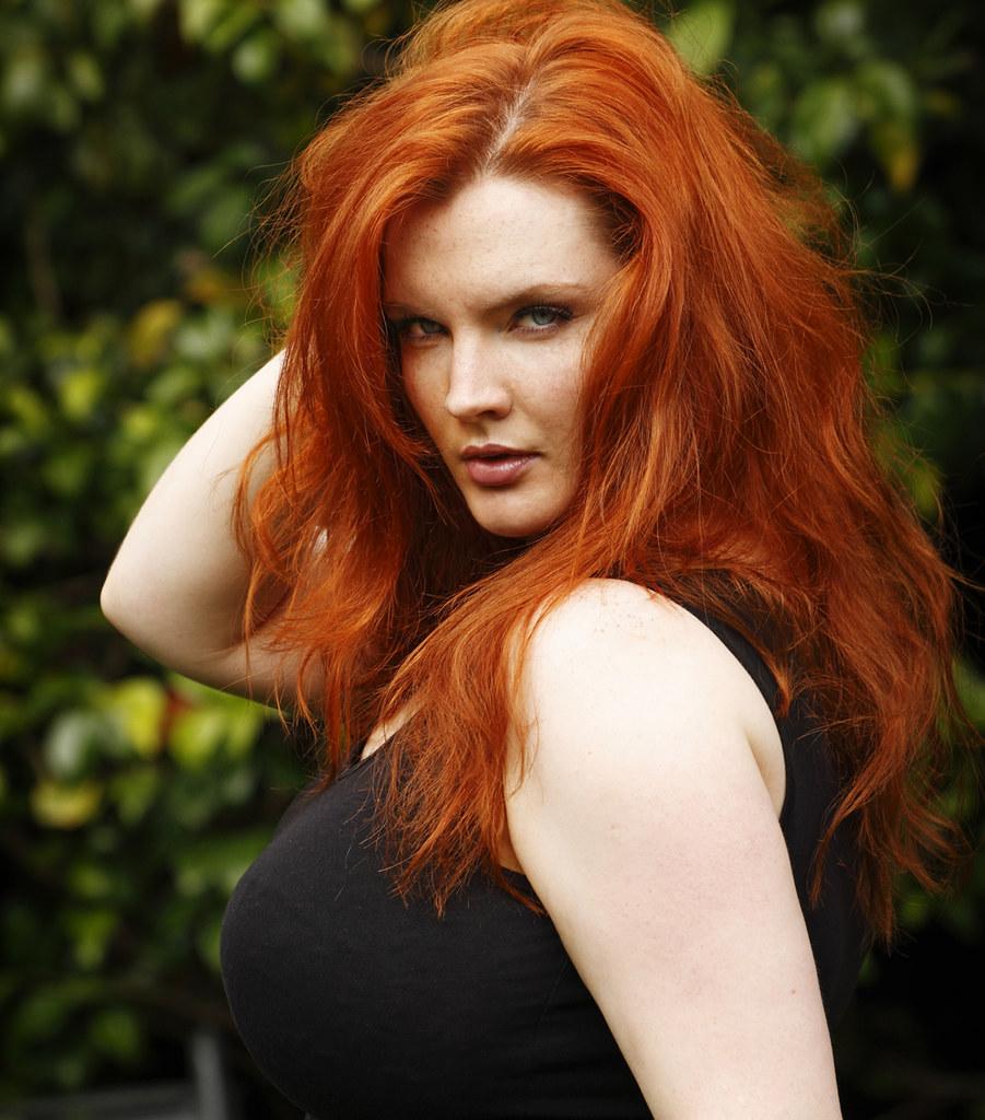 Redhead busty beauty