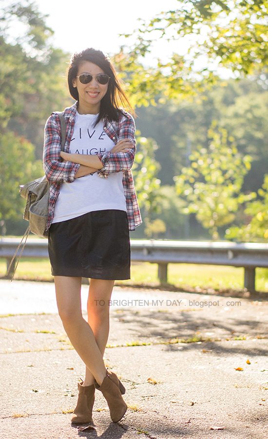 plaid button-up shirt, graphic tee, leather dress as skirt, suede ankle boots