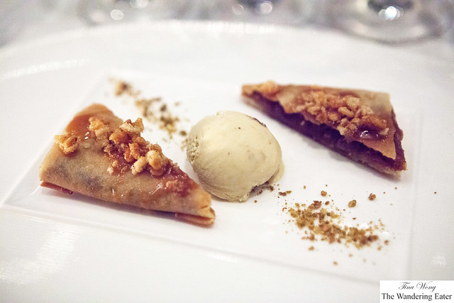 Caramelized apple tart topped with crushed caramelized popcorn, served with rum raisin ice cream