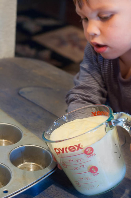 noah little boy pouring cupcake batter