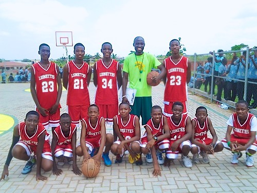 The St Louis Jubilee School basketball team and their coach getting ready to play at the festival