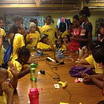 Raven, Zwena, and Bettie teaching girls to solder
