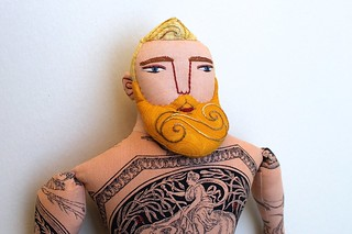 tattooed man with blond hair