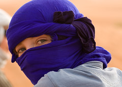 veil(0.0), dastar(0.0), flower(0.0), head(0.0), cap(0.0), costume(0.0), clothing(1.0), purple(1.0), violet(1.0), close-up(1.0), turban(1.0), blue(1.0),
