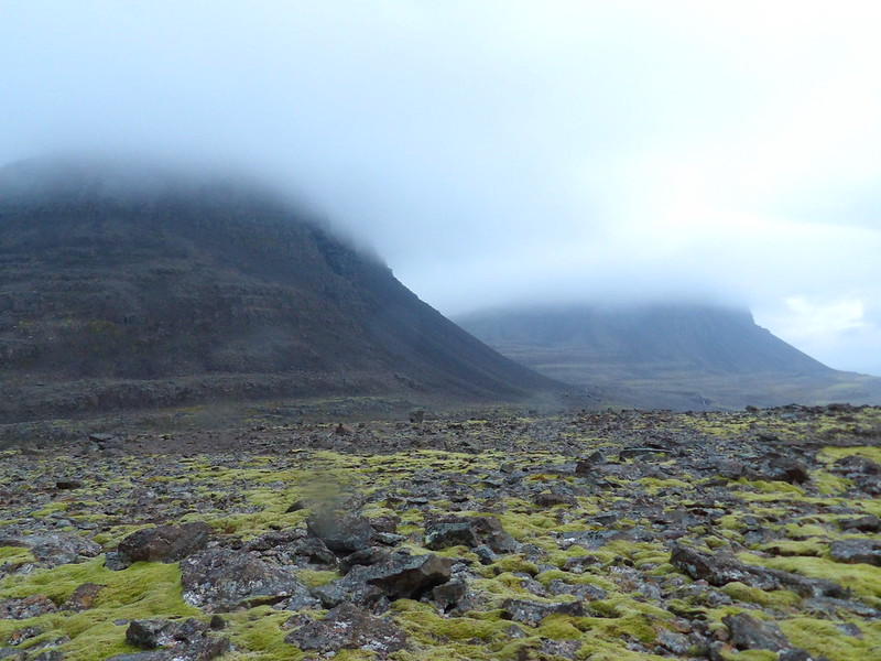 Lava fields and cloudy mountains