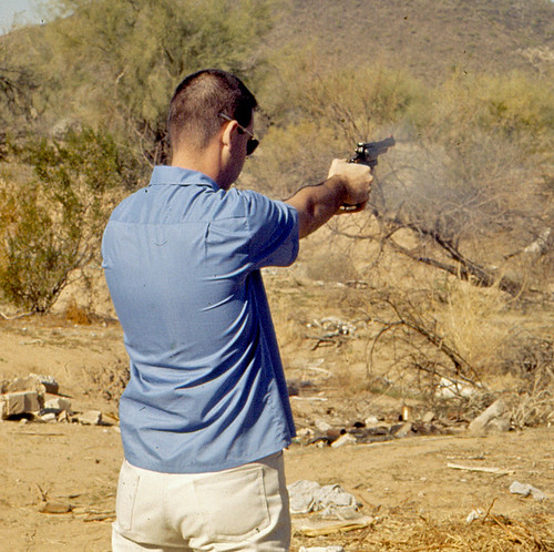 Here's Me in full recoil from my S&W Mod.19 Combat Magnum.