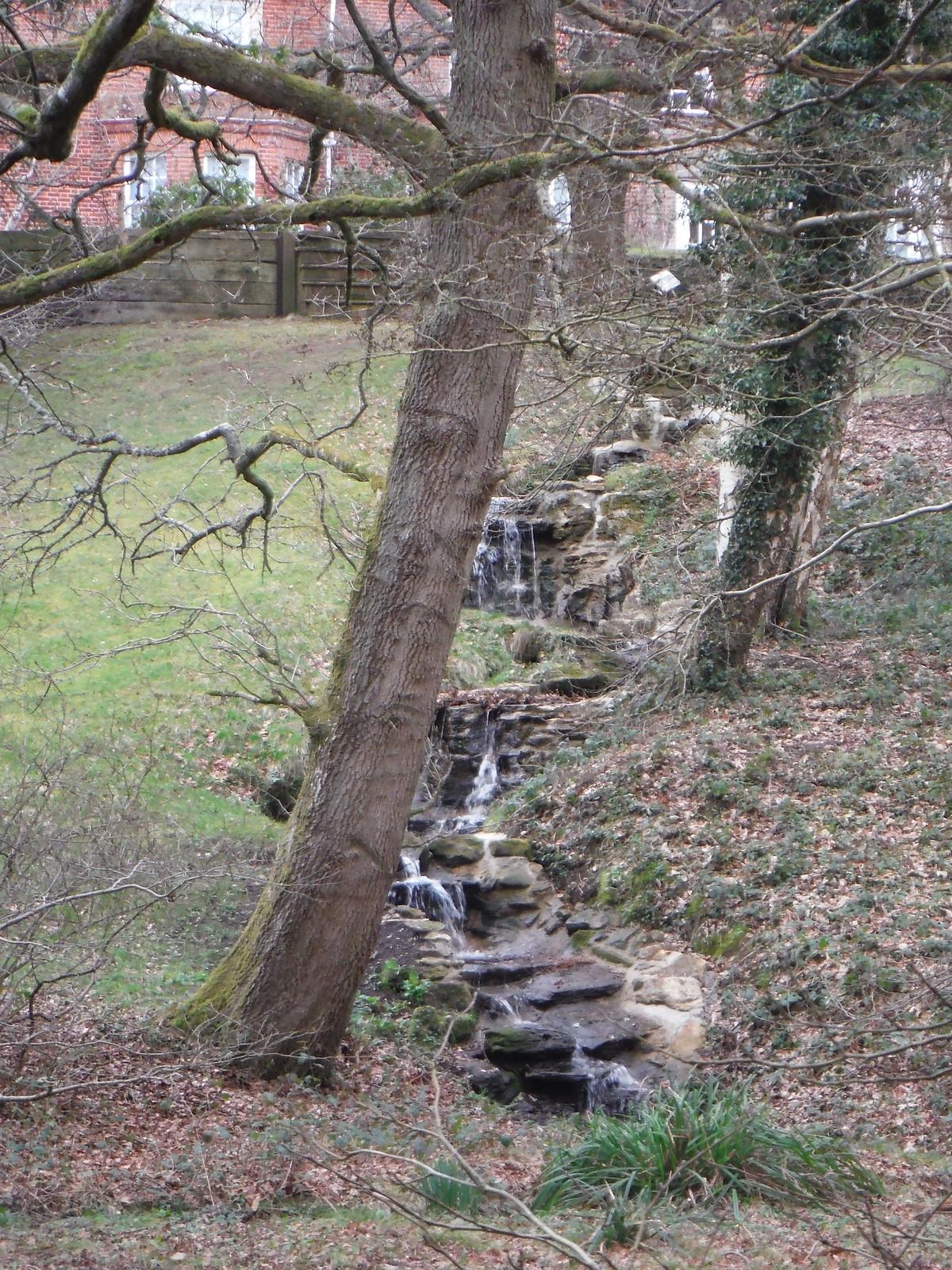 Waterfall in Garden of Dye House SWC Walk 144 Haslemere to Farnham