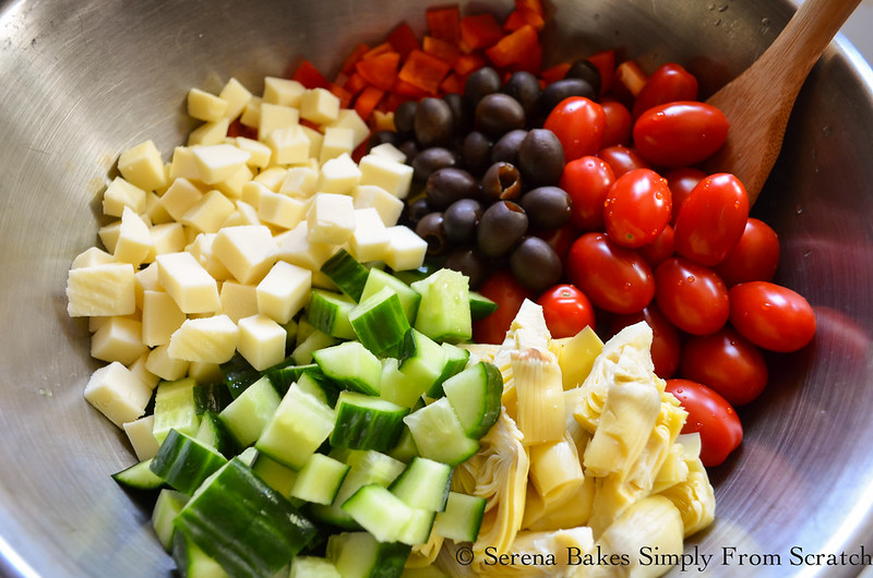 Italian-Tortellini-Pasta-Salad-Cheese-Bell-Grape-Tomatoes-Black-Olives-Artichokes-English-Cucumbers-Red-Onions.jpg