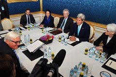 U.S. Secretary of State John Kerry, German Foreign Minister Frank-Walter Steinmeier, and their respective teams sit across from one another in Vienna, Austria, on July 13, 2014, at the start of a bilateral meeting preceding broader P5+1 talks with Iran about its nuclear program. [State Department photo/ Public Domain]