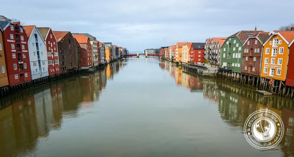 Traditional Norwegian Fishing Buildings along the Nidelva River in Trondheim