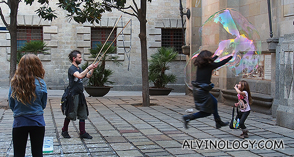 Street performer making giant bubbles