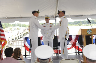 Cmdr. Andrew D. Meverden relieved Capt. David W. Ramassini of the duties and responsibilities as commanding officer of the Coast Guard Cutter Bear during a change of command ceremony at Base Portsmouth July 14, 2014.