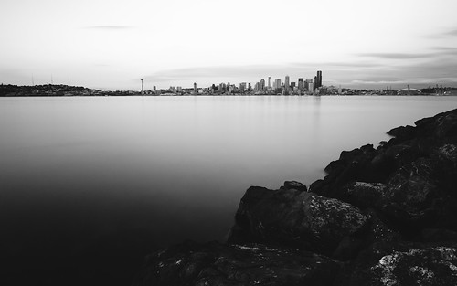 seattle longexposure blackandwhite water washington rocks cityscape shore pacificnorthwest pugetsound canonef2470mmf28lusm elliotbay bwnd1000x canoneos5dmarkiii
