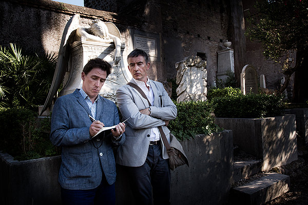 Steve Coogan and Rob Brydon pose at one of the landmarks in THE TRIP TO ITALY.