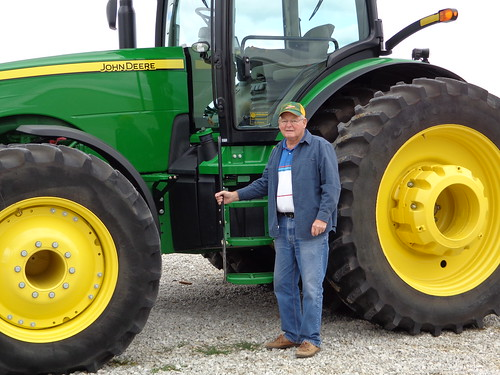 Farmer Wayne Erickson, now 83, and his current tractor. (NRCS photo)